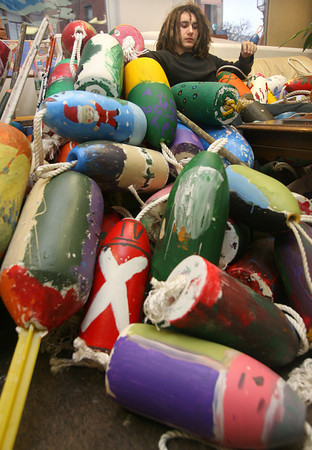 Gloucester: Andy Cleary appears buried in buoys as he helps prepare the Lobster Trap Tree buoys for the Second Annual Art Haven Buoy Auction and Art Show, which will be held at Cruiseport on January 29th from 6-9pm. Photo by Kate Glass/Gloucester Daily Times