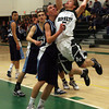 Manchester: Manchester Essex's Sean Nally collides with Wilmington's Tim McCarthy as he leaps for the hoop during their game last night. Photo by Kate Glass/Gloucester Daily Times