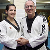 Gloucester: Andie-Jane Phinney with her taekwondo instructor, Master Philip Demetri. Phinney recently returned from the U.S. Olympic Training Facility in Colorado Springs where she won two gold medals in two tournaments. Phinney is hoping to make the 2012 Olympic Team. Photo by Kate Glass/Gloucester Daily Times