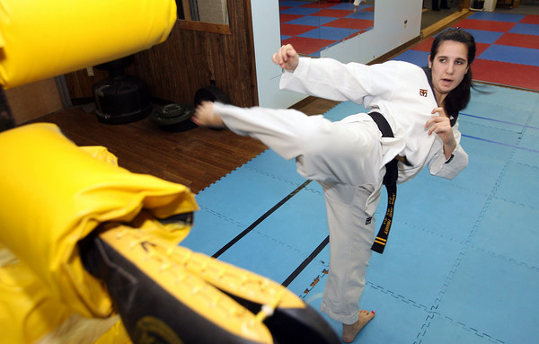 Gloucester: Andie-Jane Phinney practices her roundhouse kicks while training at Demetri's Taekwondo in Gloucester. Phinney recently returned from the U.S. Olympic Training Facility in Colorado Springs where she won two gold medals in two tournaments. Phinney is hoping to make the 2012 Olympic Team. Photo by Kate Glass/Gloucester Daily Times