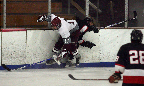 Gloucester: Rockport's Brendan Surette and Salem's Rick Merryman collide during their game at the Talbot Rink last night. Photo by Kate Glass/Gloucester Daily Times