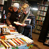 Manchester: Tricia Meier and Kathy Schulte, right, look through a table of books for sale during the book sale at Manchester Public Library Saturday morning. The sale offered adult and children's books as well as videos for sale. Mary Muckenhoupt/Gloucester Daily Times