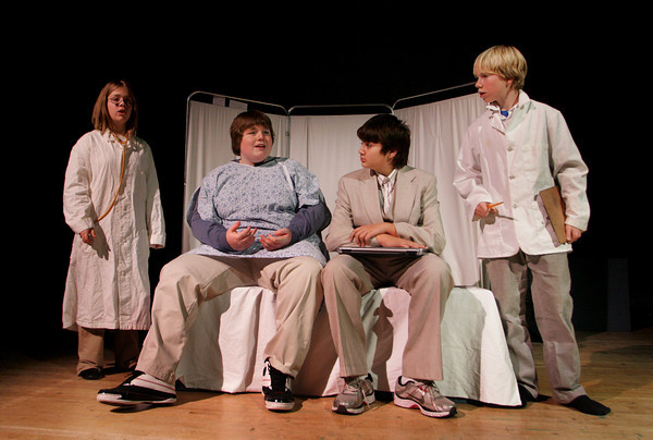 """Rockport: From left, Katherine Boucher, Kyle Schrafft, playing Charlie, Luke Andrew and Sam Rowell rehearse for """"Flowers for Algernon"""" Wednesday afternoon.  Rockport Middle School will put on the play tonight, tomorrow and Saturday at 7 p.m. at the Rockport High School Auditorium. Mary Muckenhoupt/Gloucester Daily Times"""