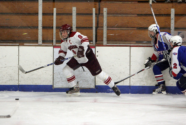 Gloucester: Gloucester's Conor Ressel keeps ahead of Swampscott defenders during the hockey game at Dorothy Talbot Rink Saturday night. Mary Muckenhoupt/Gloucester Daily Times
