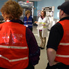 Gloucester: Chassea Robinson, Gloucester Public Health Nurse, reviews the overall plan for the flu clinic at the Fuller School yesterday, detailing responsibilities for the volunteers. Photo by Kate Glass/Gloucester Daily Times