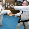 Gloucester: Andie-Jane Phinney breaks a board held by her taekwondo instructor, Master Philip Demetri, while training at Demetri's Taekwondo in Gloucester. Phinney recently returned from the U.S. Olympic Training Facility in Colorado Springs where she won two gold medals in two tournaments. Phinney is hoping to make the 2012 Olympic Team. Photo by Kate Glass/Gloucester Daily Times