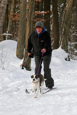 Gloucester: Laurie Hendrickson cheers as Sophia helps her pick up speed while going down a slight hill at Ravenswood Park yesterday afternoon. The parking lot was full as skiers and snowshoers flocked to the park to take advantage of the fresh snow. Photo by Kate Glass/Gloucester Daily Times Monday, January 4, 2010