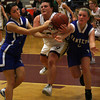 Gloucester: Gloucester's Helena Keefe is tripped up by Danvers' Joanna Zecha, left, and Allison Tivnan, right, at the Benjamin A. Smith Field House last night. Photo by Kate Glass/Gloucester Daily Times