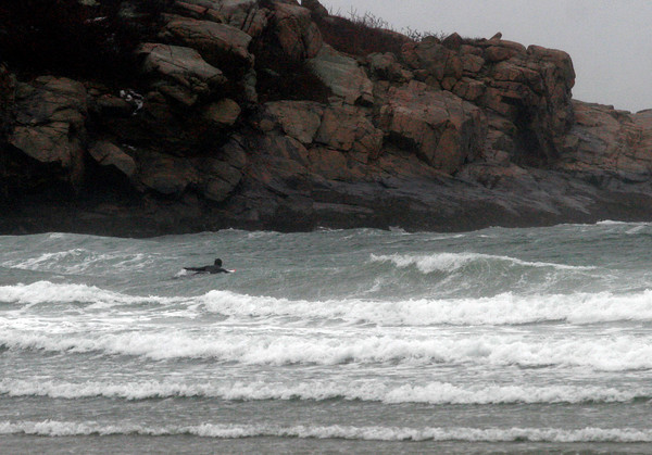Gloucester: A lone surfer paddles out in the rain searching for a few good waves during yesterday's storm. Photo by Kate Glass/Gloucester Daily Times Monday, January 25, 2010