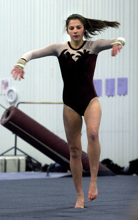 Gloucester: Gloucester's Kate Pardo spins as she performs her floor routine at Iron Rail last night. Photo by Kate Glass/Gloucester Daily Times