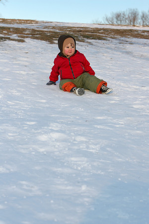 Gloucester: Leo Cosentino, 2, doesn't need a sled and would rather slide down the hill at Stage Fort Park while sledding with his brother Saturday afternoon. Mary Muckenhuopt/Gloucester Daily Times
