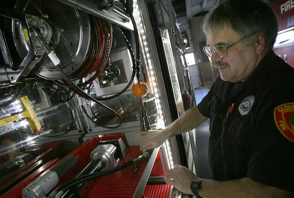 Gloucester: Jim Capillo, one of four mechanics with the Gloucester Fire Department, demonstrates the new ladder truck's jaws of life, which have a hydraulic generator built into the truck. The truck is expected to be put into commission in a week. It had been sent back to the shop for six weeks  for engine repairs. Photo by Kate Glass/Gloucester Daily Times