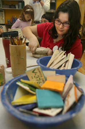 Gloucester: Abigail Feener, 9, makes a body mug at Cape Ann Art Haven during a pottery class on Tuesday afternoon. The mug will mold to her hand. Photo by Kate Glass/Gloucester Daily Times