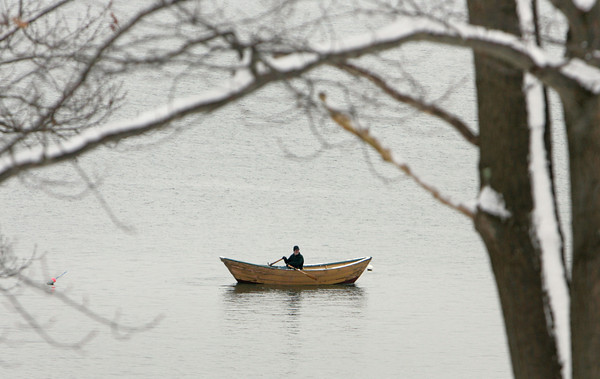 Gloucester: A rower stops by Half Moon Beach at Stage Fort Park while out in his dory on New Year's Day. Mary Muckenhoupt/Gloucester Daily Times