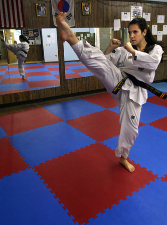 Gloucester: Andie-Jane Phinney practices one of her forms while training at Demetri's Taekwondo in Gloucester. Phinney recently returned from the U.S. Olympic Training Facility in Colorado Springs where she won two gold medals in two tournaments. Phinney is hoping to make the 2012 Olympic Team. Photo by Kate Glass/Gloucester Daily Times