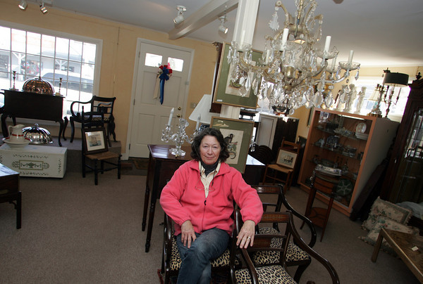 Essex: Ellen Neily, owner of Ellen Neily Antiques on Main Street in Essex sits in her store Saturday afternoon. Neily says that the causeway construction paired with the bad economy is hurting her business. Mary Muckenhoupt/Gloucester Daily Times