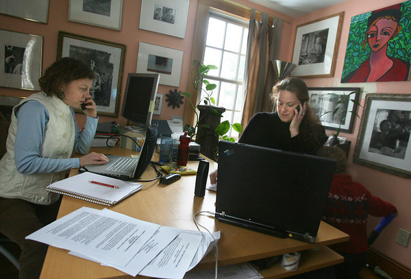 Gloucester: Elise Hansen, left, and Melinda Miles communicate with KONPAY staff members in Haiti as they coordinate sending money to help earthquake survivors from Hansen's home office in Gloucester. Photo by Kate Glass/Gloucester Daily Times