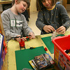 Essex: Ethan Wilber checks out Caroline Harrington's lego creation during an after school program sponsored by the Essex Youth Commission on Monday. The kids were instructed to make something they enjoyed from winter vacation or one of their favorite presents. Photo by Kate Glass/Gloucester Daily Times