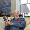 Gloucester: Gloucester artist Gordon Goetemann talks about one of the images he will be speaking about while sitting in his Rocky Neck home Thursday afternoon. Goetemann will give a gallery talk at the Cape Ann Museum on Saturday, January 16, 2010 at 10:30 a.m.  Mary Muckenhoupt/Gloucester Daily Times
