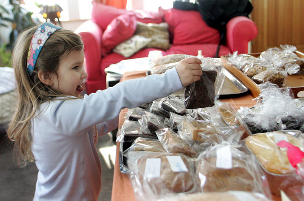 Rockport: Gracie Burbank, 3, of Rockport picks out a brownie at the bake sale for Haiti relief at the home of Gina Fettig on Stockholm Road Thursday afternoon. The bake sale, which went from 10 a.m. to 5 p.m. raised $1,300. Mary Muckenhoupt/Gloucester Daily Times