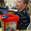 Essex: Ryan Crompton yells in protest as his lego creation from last session is taken apart so he can build something new during the Essex Youth Commission's Lego Building Club at Essex Elementary School on Monday afternoon. Despite the sad face, Ryan quickly went to work on a Star Wars themed creation. Photo by Kate Glass/Gloucester Daily Times