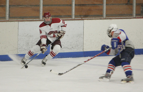 Gloucester's Salvatore Taormina maneuvers around Swampcott's Colby Wollerscheid during the hockey game held at Dorothy Talbot Rink Saturday night. Mary Muckenhoupt/Gloucester Daily Times