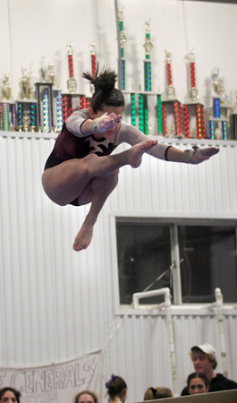 Gloucester: Gloucester's Kiley Aiello leaps high above spectators as she performs on the balance beam at Iron Rail last night. Photo by Kate Glass/Gloucester Daily Times