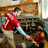 Goucester: Gloucester lineman Gus Margiotta hands a football to some students in Beth Lafata's classroom as Margiotta and teammate Conor Ressel spoke to the fifth grade students about how the benefits of hard work at Beeman Elementary School Thursday morning.  The students took turns passing the football around and talking about their personal goals.  The program, which is a collaborative effort between Gloucester High school and the Cape Ann Moose Lodge, consists of eight students who speak to elementary school students about such topics as bullying and the importance of good manners.  The presenters are attempting to qualify for scholarships offered by the International Moose Organization. Mary Muckenhoupt/Gloucester Daily Times