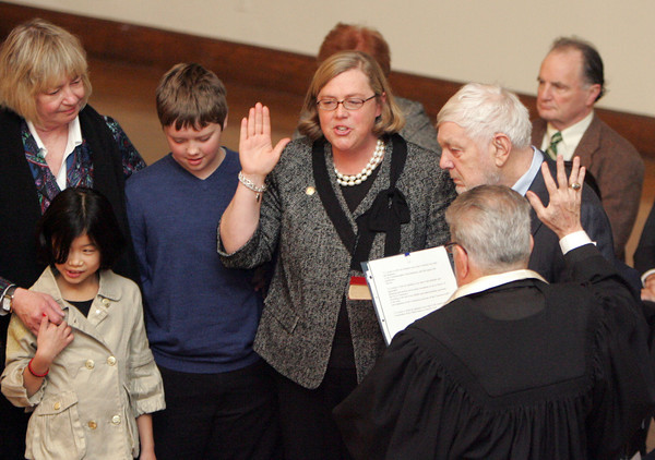 Gloucester: Mayor Carolyn Kirk gets sworn in by Bob Whynott while standing with family members including her father Jay Anderson, her son Sam, daughter Baylee and mother-in-law Sally Anderson at the Inaguration Ceremonies at Gloucester City Hall Friday afternoon.  Mayor Carolyn Kirk, School Committee members and City Council members were all sworn into office in the Kyrouz Auditorium. Mary Muckenhoupt/Gloucester Daily Times