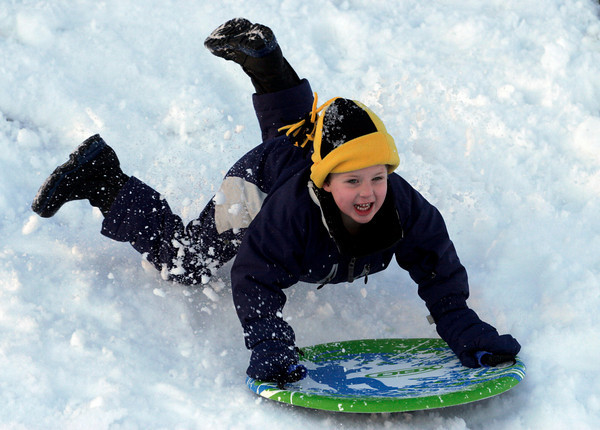 Essex: Sam Phippen, 4, flies off his sled as he hits a bump on the hill behind Essex Town Hall Thursday afternoon. Photo by Kate Glass/Gloucester Daily Times