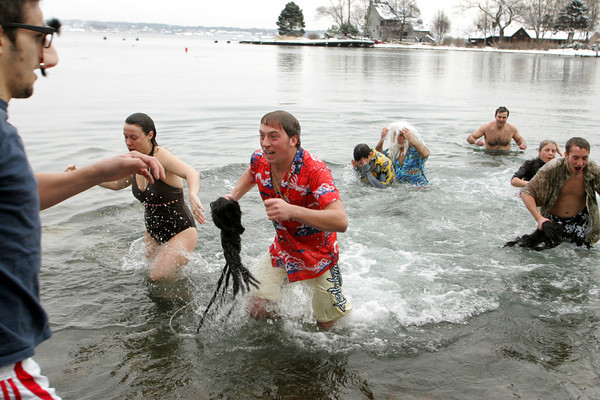 Gloucester: Zach Trotsky runs out of the water as quickly as he can after taking a dip at Freshwater Cover for the New Year's Day swim Friday morning.  This was the first New Year's swim at Freshwater Cover and organizers hope it becomes an annual event. Mary Muckenhoupt/Gloucester Daily Times