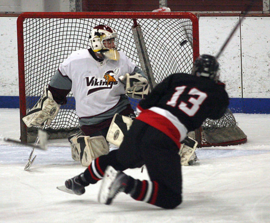 Gloucester: Salem's Jessie Wilkins gets a shot past Rockport goalie Colby Foster in the first period of their game at the Talbot Rink last night. Photo by Kate Glass/Gloucester Daily Times