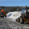 Rockport: Rockport DPW Employees dump snow from the town's sidewalks at Granite Pier. Sidewalk cleanup is expected to be finished today.<br /> Photo by Kate Glass/Gloucester Daily Times