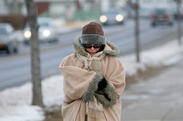 "Gloucester: Toni Molinski of Gloucester walks Stacy Boulevard all bundled up to stay warm on Friday afternoon.  Molinski walks the boulevard at least once a day, sometimes twice, which she says equals 9 weeks worth of time. ""Running my own business I never get any vacation time but I do get nine weeks a year on the water.""  Mary Muckenhoupt/Gloucester Daily Times"