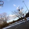 Manchester: Liam Logue, 14, of Manchester takes a few shots at Sweeney Park on Wednesday afternoon. Logue shoveled off part of the court to play because not all the snow had melted. Photo by Kate Glass/Gloucester Daily Times