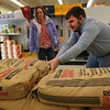Gloucester: James Frontiero helps Maureen Higgins load traction sand into her shopping cart at ACE Hardware yesterday. ACE employees said many people were coming in to get supplies to deal with the storm, but they will also be open tomorrow during the storm. Photo by Kate Glass/Gloucester Daily Times