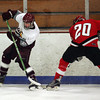 Gloucester: Rockport's Michael Tupper, left, tries to keep the puck away from an Amesbury defender during the hockey game at Dorothy Talbot Rink Wednesday night. Mary Muckenhoupt/Gloucester Daily Times