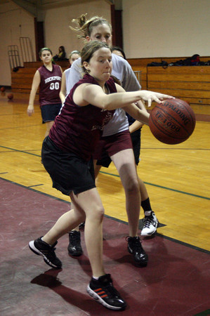 Rockport: Elizabeth Saville tries to keep the ball from going out of bounds as the Rockport varsity and junior varsity scrimmage during practice yesterday. Their game against Essex Aggie was postponed for the second time due to weather. It is now scheduled for next Wednesday. Photo by Kate Glass/Gloucester Daily Times