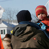 Rockport: Asher Sauder, 2, gets a lift from his father, Tim Sauder, as they march in the 23rd Annual Martin Luther King Jr. Walk yesterday, which is organized by the Rockport Unitarian Universalist Church. Photo by Kate Glass/Gloucester Daily Times