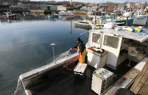 Rockport: Richie Balzarini hoses down the Ella Briggs after unloading lobsters at Pigeon Cove yesterday afternoon. Balzarini said it was a great day to be on the boat due to the warm weather and calm seas. Photo by Kate Glass/Gloucester Daily Times
