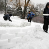 Rockport: From right: Dan DeMarco, Frank Evans and Jake Moss build an igloo at Millbrook Meadow yesterday afternoon using tupperware containers to shape the snow into bricks. Photo by Kate Glass/Gloucester Daily Times