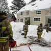 Essex: Firefighters from Essex, Manchester and Hamilton respond to a fire at 76 Forest Avenue Wednesday afternoon. The fire was mostly contained to the basement and there were no injuries. Mary Muckenhoupt/Gloucester Daily Times