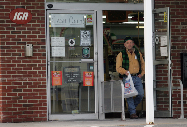 Rockport: Eric Cefalo leaves the IGA market in Rockport Thursday afternoon.  The IGA is having a fifty percent off sale and is only accepting cash before closing for renovations on Sunday. Mary Muckenhoupt/Gloucester Daily Times