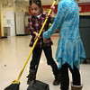 Manchester: Jessica Khani and Ellie Toner help sweep up the mess left by their arts and crafts project during the Hornet's After School Program. Photo by Kate Glass/Gloucester Daily Times