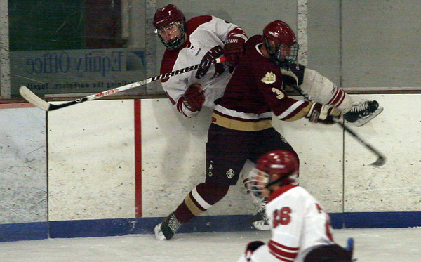Gloucester: Newburyport's Adam McElroy upends Gloucester's Ben Favazza at the Talbot Rink last night. Photo by Kate Glass/Newburyport Daily News