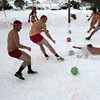 "Essex: Noah Goldstein dives in the snow to get the ball before Sean Fitzgerald as ""Five in the Pink"" and ""The Farm"" compete in the championship game of the Bikini and Speedo Dodgeball Tournament at the Farm Bar & Grille in Essex on Saturday. The event raised over $500 for breast cancer research and the restaurant hopes to make the fundraiser an annual event. Photo by Kate Glass/Gloucester Daily Times"
