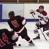 Gloucester: Gloucester's Peter Mondello knocks the puck past Marblehead's  Tom Koopman during their game at the Talbot Rink on Saturday night. Photo by Kate Glass/Gloucester Daily Times