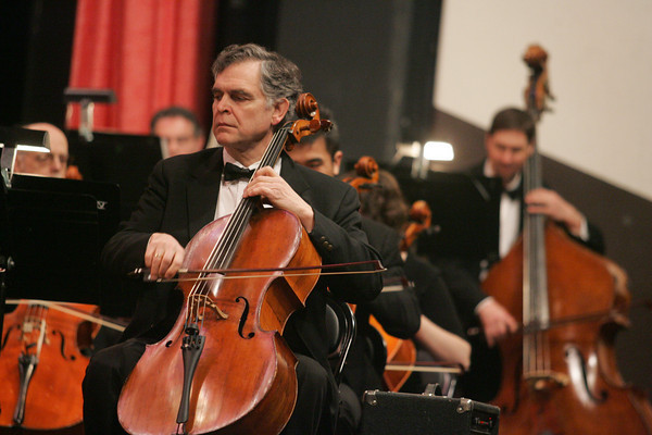 """Gloucester: Stephen Smith plays the cello during the youth outreach concert put on  at the Fuller Auditorium Friday morning.  Two concerts were performed for over 1,000 Cape Ann students, some of whom had their artwork of fireworks displayed during the """"1812 Overture"""" which was the last song performed.  Mary Muckenhoupt/Gloucester Daily Times"""