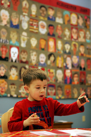 Gloucester: Jackson Altieri, 4, of Gloucester works on making patterns with stamps, much like the patterns found in granite, in one of the Cape Ann quaries arts and crafts activities at the Cape Ann Museum for Family Fun Free Day Saturday. The Cape Ann Museum is also offering free admission to Cape Ann residents for the month of January. Mary Muckenhoupt/Gloucester Daily Times