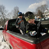 Manchester: Matthew DeOreo, 2, finds a chunk of ice while he and his brother Michael, 5, help shovel out some snow from the back of their dad's truck at the parking lot on Brook Street in Manchester Saturday afternoon. Mary Muckenhoupt/Gloucester Daily Times